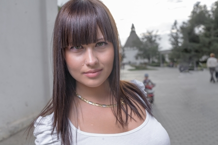 Outdoors street portrait of beautiful young brunette girl Stock Photo - 19804296