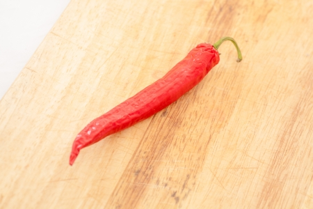 Red Hot Chili Peppers over wooden background photo