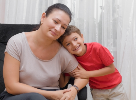 Happy mother and little son in the living room, happy time and togetherness photo