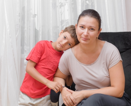 Portrait of Mother with happy son at home photo