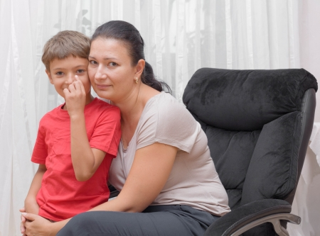 Happy mother and little son indoors front view, happy time and togetherness photo