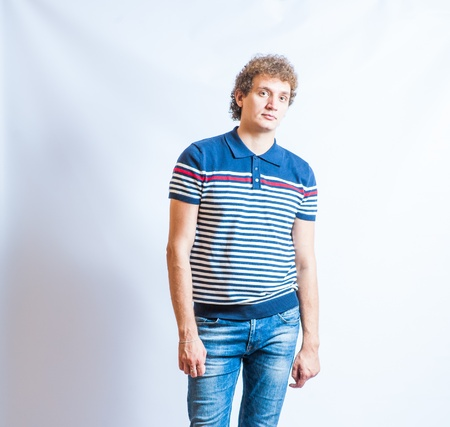 Portrait of the young happy smiling man in jeans on a gray background Stock Photo - 21542517