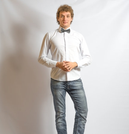 young fashion male model wearing bow tie  on gray background Stock Photo - 21562461