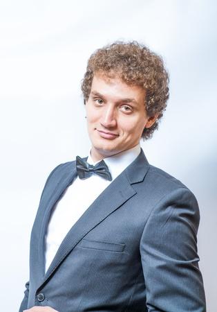 Portrait of handsome man in the black suit torso shot photo