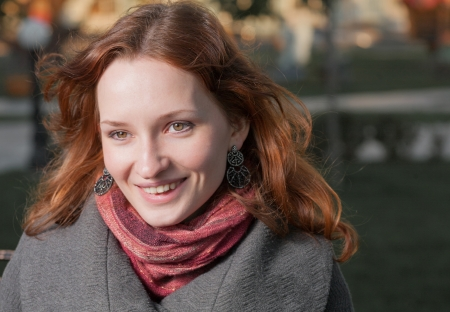 ginger haired: Ginger haired women smiling outdoors in autumn  fall  city park Stock Photo
