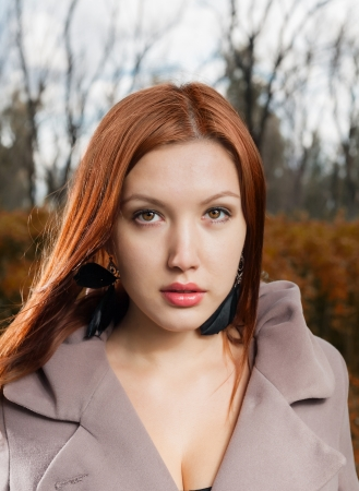 ginger haired: foxy-red haired women outdoors weared jacket at autumn time Stock Photo