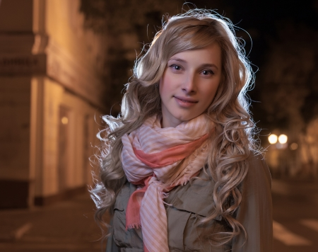 20 to 25 years old: Portrait of a young female businesswoman in night city  Close-up Stock Photo