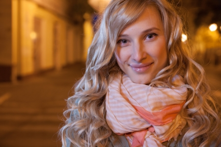 20 to 25 years old: Portrait of a young female businesswoman in night city  Close-up, shallow DOF  Stock Photo
