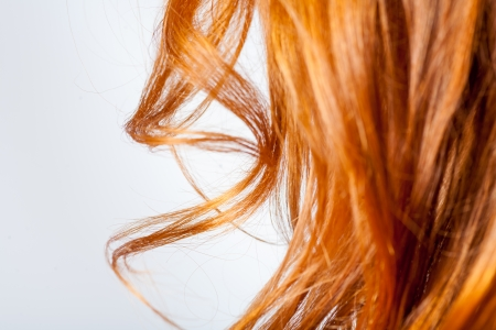 to cut: ginger red (carrot top) curly hair closeup