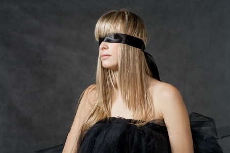 Blindfolded girl waiting  She weared black tutu skirt photo