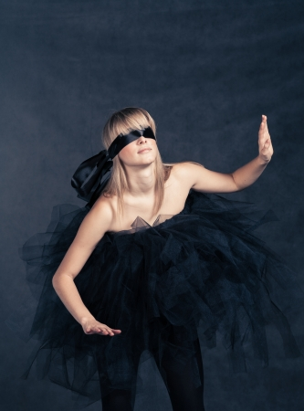 Blindfolded girl searching for  She weared black tutu skirt photo