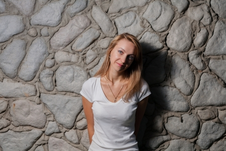 blonde female against wall outdoor photo
