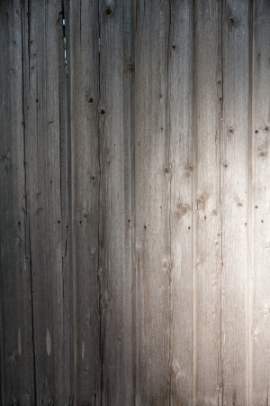 wooden plank with spot of light as background photo