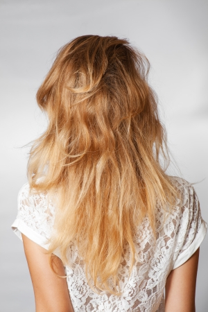 back view of the blond haired female, head and  shoulders shot photo