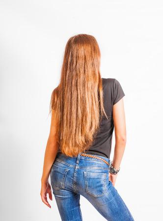 long blond haired female from back, torso shot in  studio Stock Photo