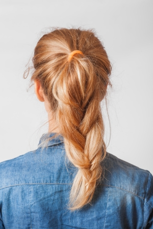 back view of the blond haired female with braid  pigtale , head and  shoulders shot photo