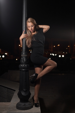 blonde posing outdoor at night photo