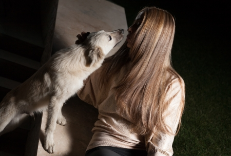 blonde outdoor with dog Stock Photo - 23642373
