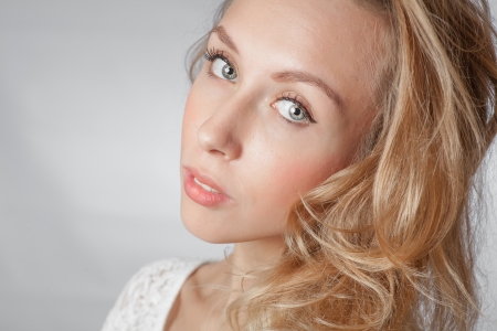 closeup of the face, blond women with long hair studio shot on white background photo