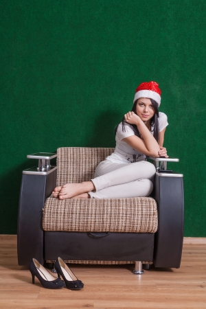 happy mrs  Santa sitting indoor on armchair photo