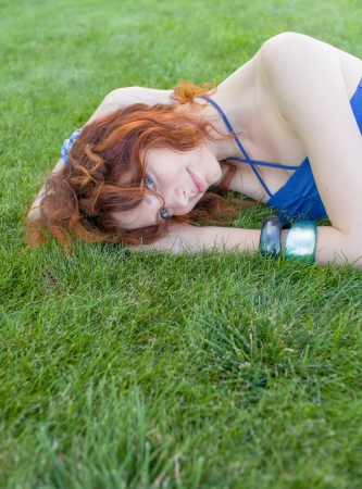 redhead on grass, copyspace Stock Photo