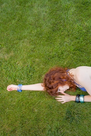 redhead slipping grass photo
