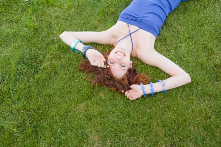 redhead lay on grass Stock Photo