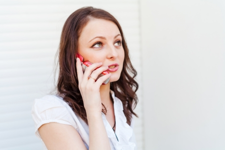 20 24 years old: Businesswomen  calling by phone  Brunette using cell phone indoor
