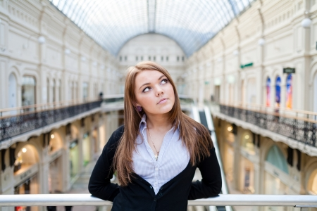 Photo of young beautiful lady inside the big mall  Central composition shot  Stock Photo