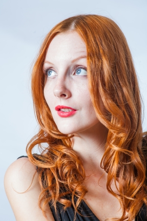 redhead women in studio  Head and shoulders shot  Looking up  photo
