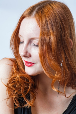 redhead in studio, closed eyes photo