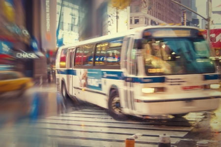 NYC bus in the street, blurred image