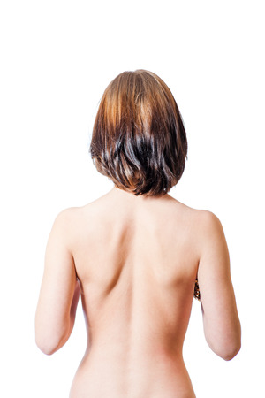 bare back shot of the sporty female, isolated on white photo