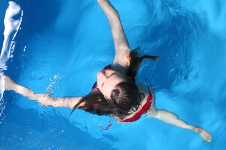 Young Red Bikini Female In Swimming in Pool photo