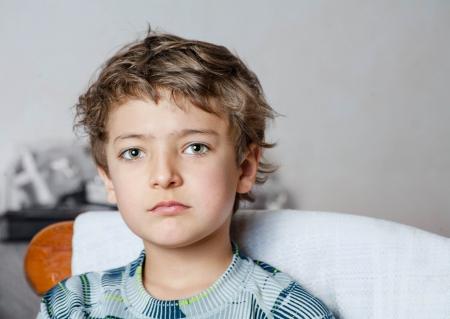 sad boy: sad boy looking at camera
