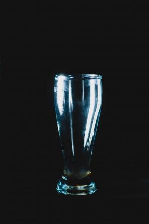 bourbon whisky: empty shot glass on black