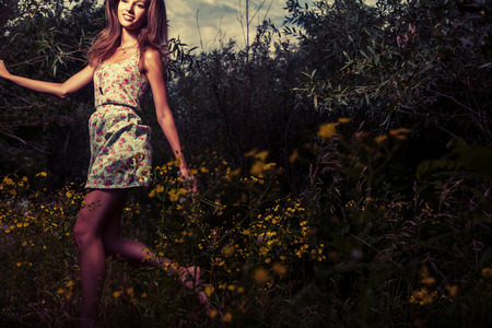 colorized: Colorized image of the happy girl run outdoors in summertime Stock Photo