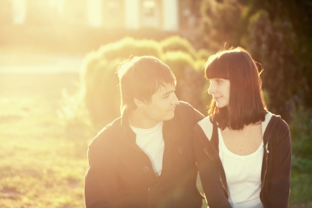 couples outdoors: Young beautiful romantic couple in backlit composition