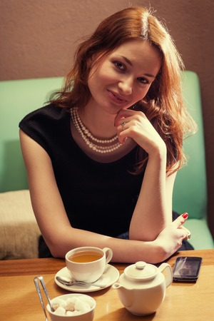 redhead women sitting in cafe front view photo