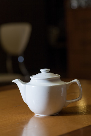 white teapot on table photo