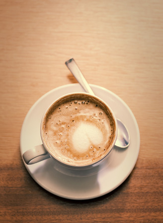 Coffee cup with milk on the table and copy-space photo