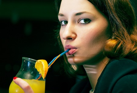 adult sexy: women drinking cocktail colorized image