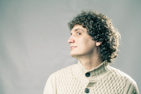 profile view: Profile view of a curly white man in studio