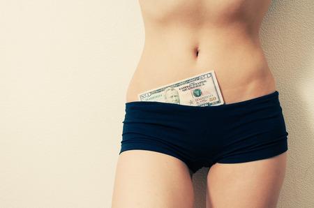 50 dollar bill: Female in shanties (tight shorts) with 50 dollar bill in Stock Photo