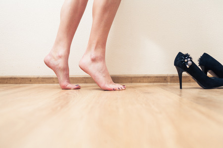 Bare feet female low section view inrofile photo