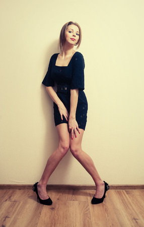 Sexy girl posing against wall full body shot  Colorized image photo