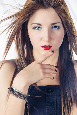 Blonde women touching her lips by finger photo