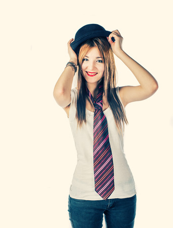 Cute girl having fun with bower and tie toned image photo