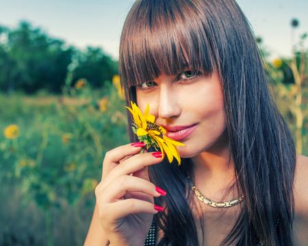 Health and beauty from mother Nature. Women smelling sunflower photo