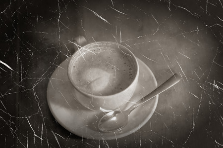 Love and coffee  Cup of cofee on a table vintage looking photo imitation  photo